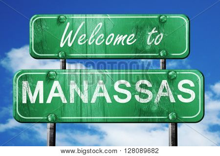 manassas vintage green road sign with blue sky background