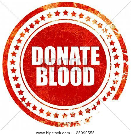 donate blood, grunge red rubber stamp with rough lines and edges