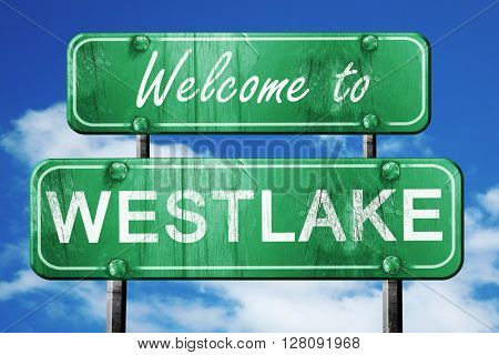 westlake vintage green road sign with blue sky background