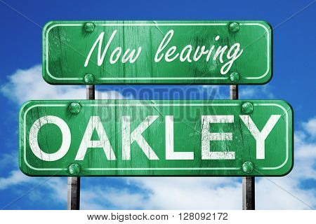 Leaving oakley, green vintage road sign with rough lettering