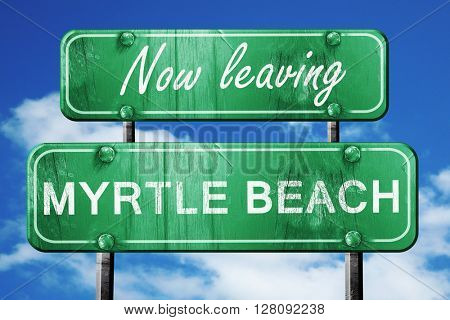 Leaving myrtle beach, green vintage road sign with rough letteri