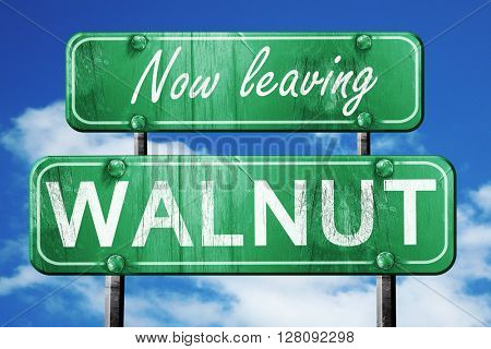 Leaving walnut, green vintage road sign with rough lettering