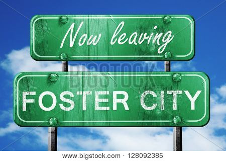 Leaving foster city, green vintage road sign with rough letterin