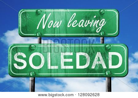 Leaving soledad, green vintage road sign with rough lettering