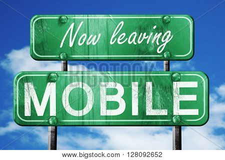 Leaving mobile, green vintage road sign with rough lettering