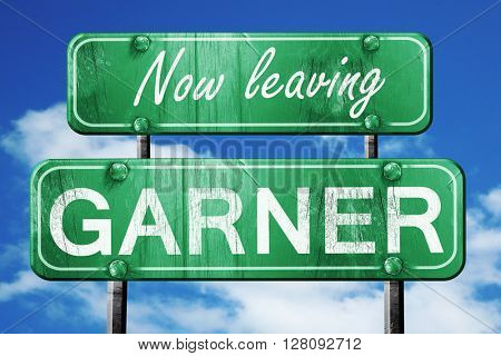 Leaving garner, green vintage road sign with rough lettering