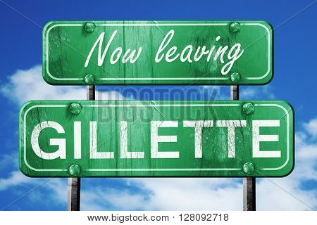 Leaving gillette, green vintage road sign with rough lettering