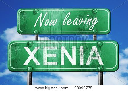 Leaving xenia, green vintage road sign with rough lettering