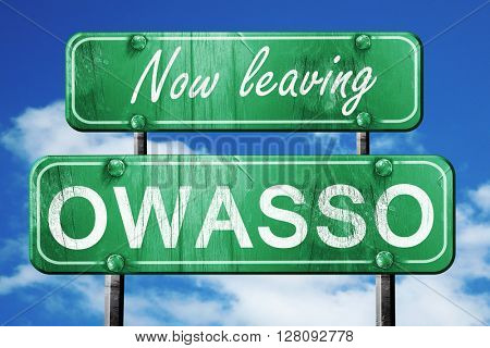 Leaving owasso, green vintage road sign with rough lettering