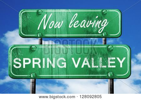 Leaving spring valley, green vintage road sign with rough letter