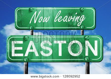 Leaving easton, green vintage road sign with rough lettering