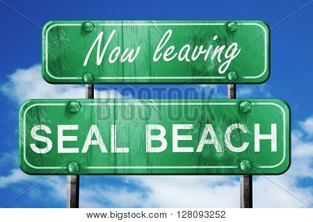 Leaving seal beach, green vintage road sign with rough lettering