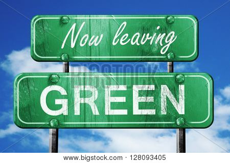 Leaving green, green vintage road sign with rough lettering