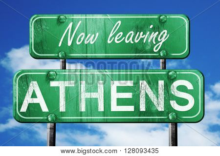 Leaving athens, green vintage road sign with rough lettering