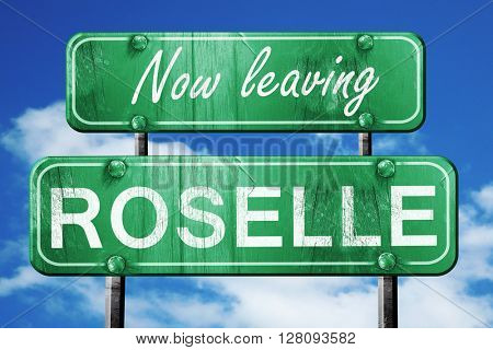 Leaving roselle, green vintage road sign with rough lettering