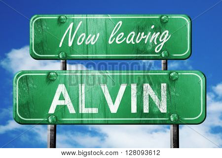 Leaving alvin, green vintage road sign with rough lettering