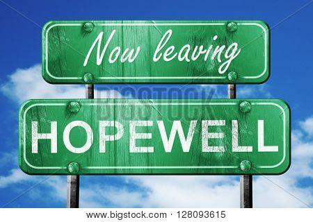 Leaving hopewell, green vintage road sign with rough lettering