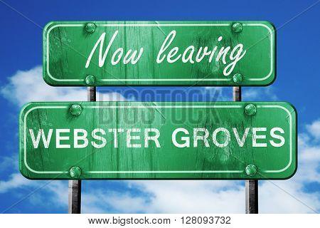 Leaving webster groves, green vintage road sign with rough lette