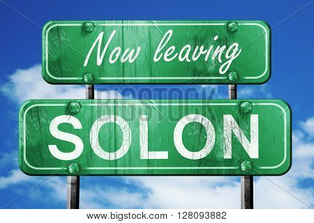 Leaving solon, green vintage road sign with rough lettering