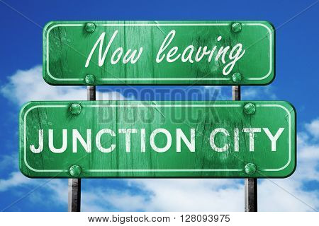 Leaving junction city, green vintage road sign with rough letter