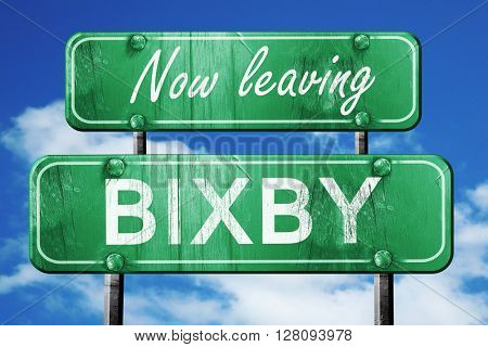 Leaving bixby, green vintage road sign with rough lettering