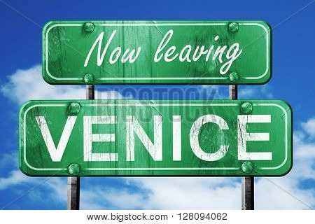 Leaving venice, green vintage road sign with rough lettering