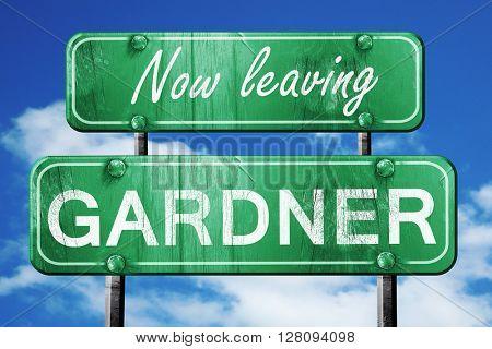 Leaving gardner, green vintage road sign with rough lettering