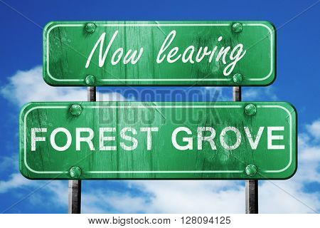 Leaving forest grove, green vintage road sign with rough letteri