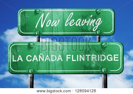Leaving la canada flintridge, green vintage road sign with rough