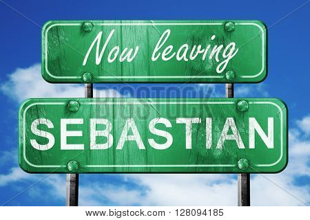 Leaving sebastian, green vintage road sign with rough lettering
