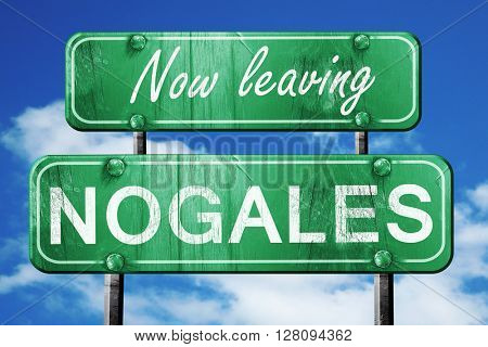 Leaving nogales, green vintage road sign with rough lettering