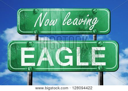 Leaving eagle, green vintage road sign with rough lettering