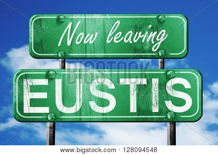 Leaving eustis, green vintage road sign with rough lettering