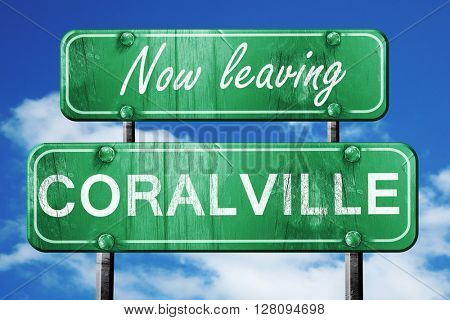 Leaving coralville, green vintage road sign with rough lettering