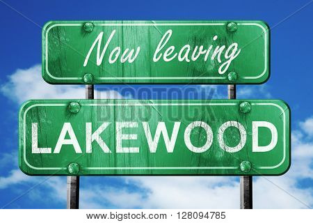 Leaving lakewood, green vintage road sign with rough lettering