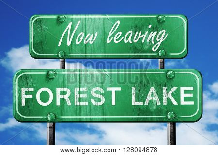 Leaving forest lake, green vintage road sign with rough letterin