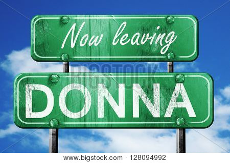 Leaving donna, green vintage road sign with rough lettering