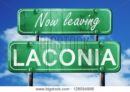 Leaving laconia, green vintage road sign with rough lettering