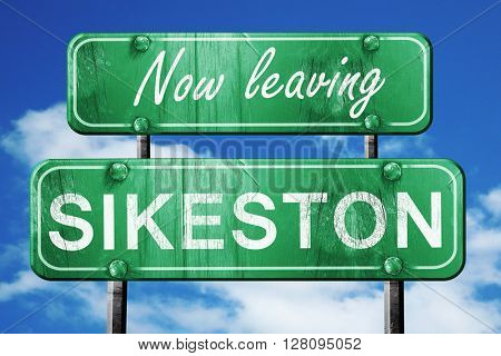 Leaving sikeston, green vintage road sign with rough lettering