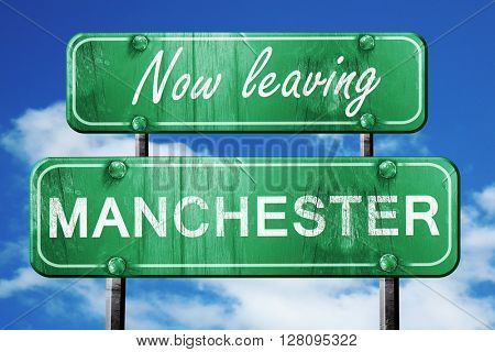 Leaving manchester, green vintage road sign with rough lettering