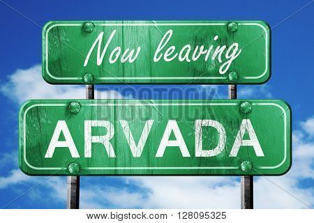 Leaving arvada, green vintage road sign with rough lettering