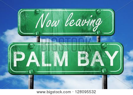 Leaving palm bay, green vintage road sign with rough lettering