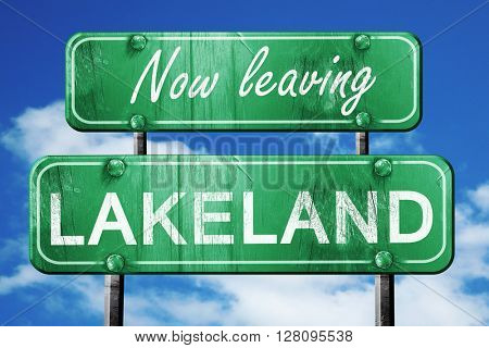 Leaving lakeland, green vintage road sign with rough lettering