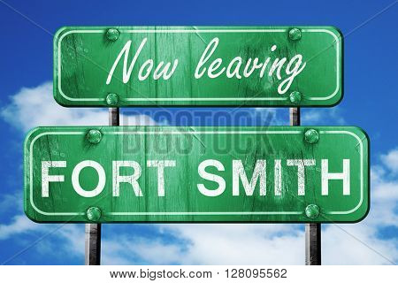 Leaving fort smith, green vintage road sign with rough lettering