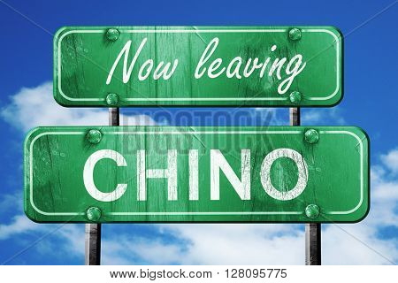 Leaving chino, green vintage road sign with rough lettering