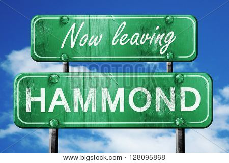 Leaving hammond, green vintage road sign with rough lettering
