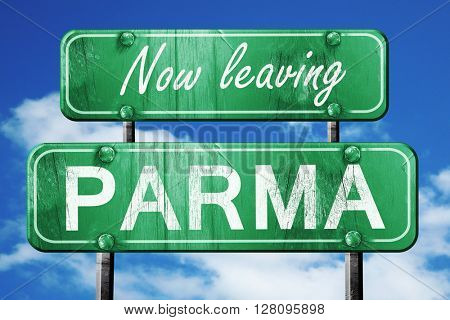 Leaving parma, green vintage road sign with rough lettering