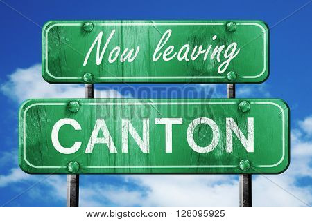 Leaving canton, green vintage road sign with rough lettering