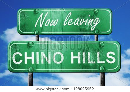 Leaving chino hills, green vintage road sign with rough letterin