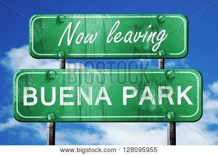Leaving buena park, green vintage road sign with rough lettering